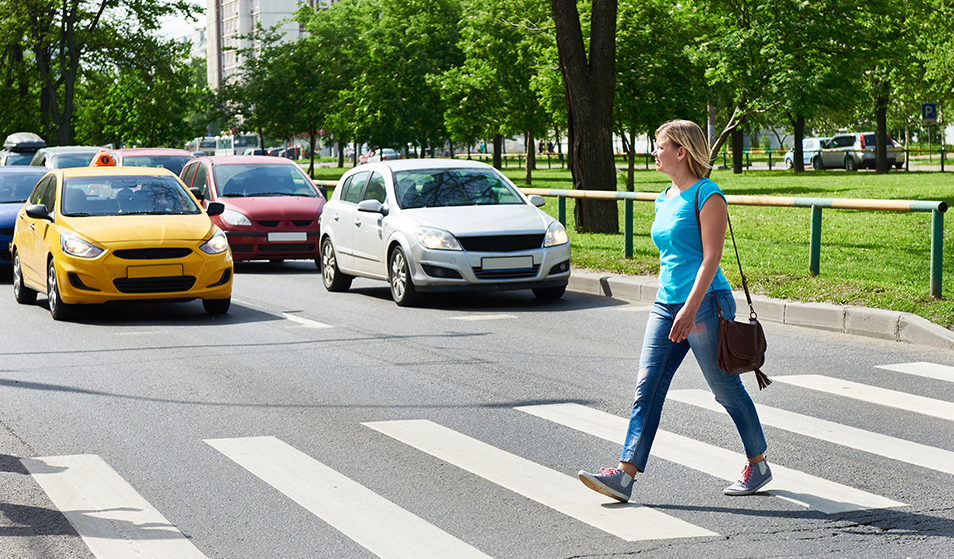 women crossing street